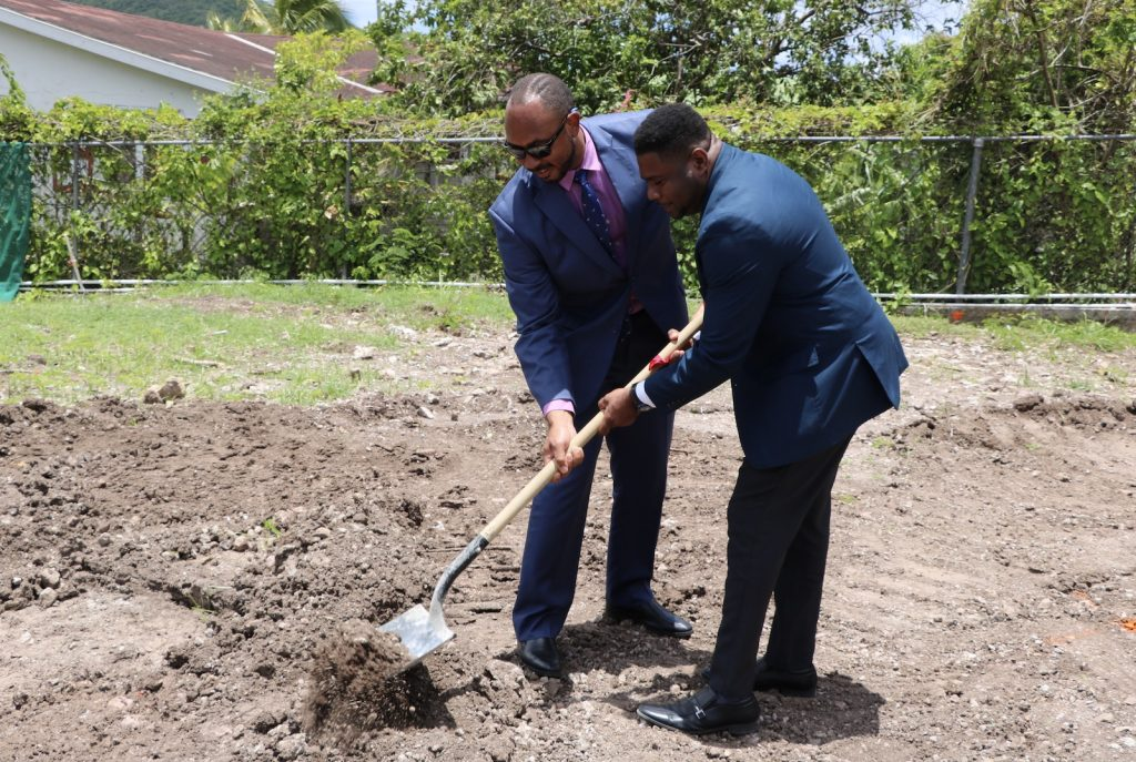 Hon. Jonel Powell, Federal Minister of Education; and Hon. Troy Liburd, Junior Minister of Education in the Nevis Island Administration, turn the sod to signal the start of construction of a state-of-the-art multipurpose technical wing at the Gingerland Secondary School on August 06, 2020, as part of an US$8million St. Kitts and Nevis Technical Vocational Education and Training (TVET) Enhancement Project