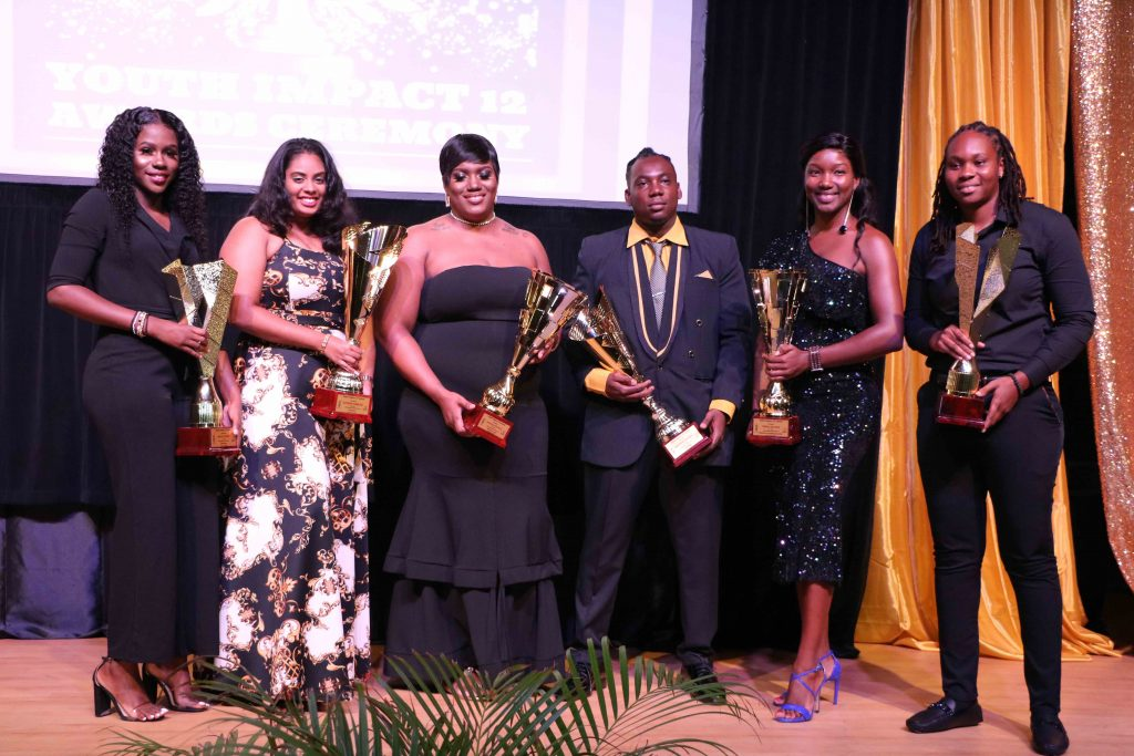 Six awardees at the Youth Impact 12 Awards Ceremony hosted by the Department of Youth on August 12, 2020, at the Nevis Performing Arts Centre (l-r) Delcia Burke awarded for Volunteerism; Raveena Persaud awarded for Extraordinary Youth in Agriculture; Cecelia Stanley awarded for Youth in Entrepreneurship; Brandon Powell awarded for Youth in Technology; Verna Grant awarded for Education and Life-long Learning; and Melicia Clarke awarded for Sports Excellence