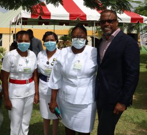 Hon. Mark Brantley, Premier of Nevis and Minister of Finance in the Nevis Island Administration (far right) with nurses at the Alexandra Hospital in Charlestown (file photo)