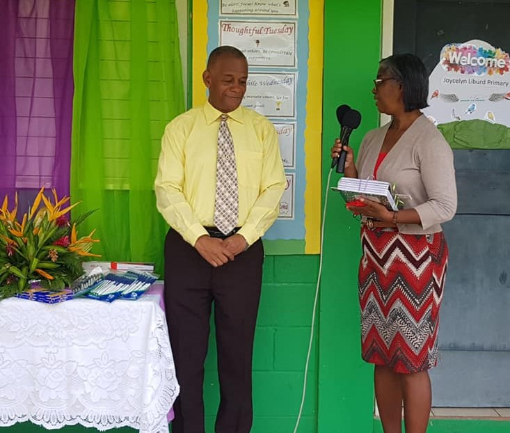 (l-r) St. George's Parish Representative Hon. Eric Evelyn, Minister of Youth and Community Development in the Nevis Island Administration and Ms. Barbara Hendrickson, principal of the Joycelyn Liburd Primary School in Gingerland during a ceremony for the donation of school supplies to the students on September 24, 2020