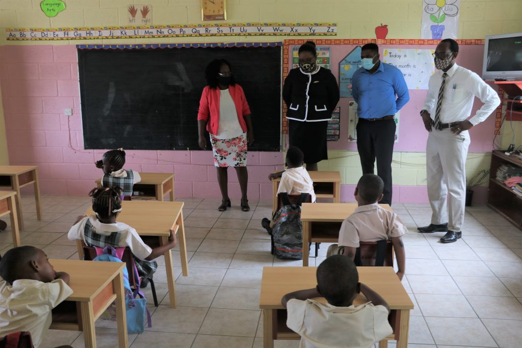(l-r) Mrs. Cheryl Haynes, Principal of the Charlestown Primary School; Ms. Zahnela Claxton, Principal Education Officer in the Department of Education; Hon. Troy Liburd, Junior Minister of Education in the Nevis Island Administration; and Mr. Kevin Barrett, Permanent Secretary in the Ministry of Education during a tour of the Charlestown Primary School on the first day of the 2020/2021 academic school year on September 07, 2020