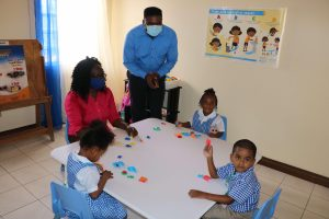 Hon. Troy Liburd, Junior Minister of Education in the Nevis Island Administration interacts with staff and students during a tour of the Farms Estate extension of the Charlestown Preschool on September 07, 2020