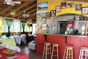 Inside Rodney's Cuisine in Stoney Grove reflects the colours of the flag of St. Kitts and Nevis