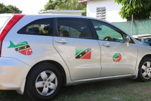 Rodney Elliott's car with stickers reflecting the flag of St. Kitts and Nevis
