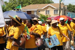 Older persons on Nevis marching through Charlestown in observance of International Month of Older Persons hosted by the Social Services Department in the Ministry of Social Development (file photo)
