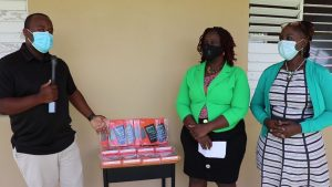(l-r) Irvine Pinney Jr. representing local business RG Solomon & Sons Ltd. presents 14 Amazon Fire 7 tablets to Mrs. Terres Dore, Education Officer with the Department of Education responsible for the Cecele Browne Integrated School and Mrs. Violet Clarke, Head Teacher of the Cecele Browne Integrated School on October 09, 2020