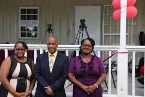 """Ms. Azilla Clarke, focal point for OECS/USAID Juvenile Justice Reform Project in St. Kitts and Nevis, Hon. Eric Evelyn, Minister and Social Development in the Nevis Island Administration, and Ms. Sandra Maynard, Director of the Department of Social Services on Nevis at the October 27, 2020 opening of the """"Yes To Success"""" skills training and diversion site at Pinney's Estate, Nevis"""