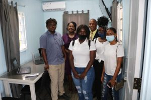 "(back row l-r) Ms. Sandra Maynard, Director of the Department of Social Services on Nevis; and Hon. Eric Evelyn, Minister Social Development in the Nevis Island Administration; with programme participants at the October 27, 2020 opening of the ""Yes To Success"" skills training and diversion site at Pinney's Estate, Nevis"