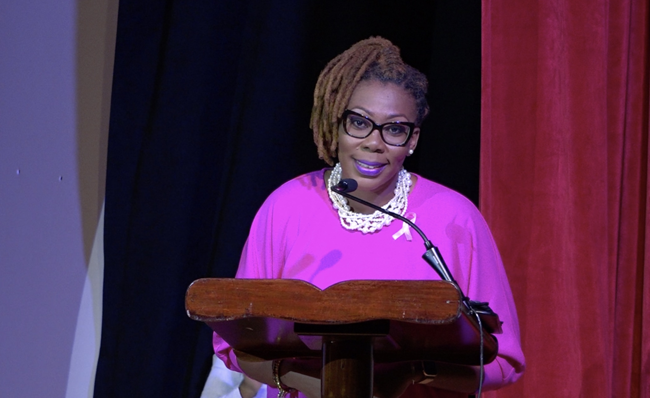 Ms. Camara Lee, a breast cancer survivor from Nevis, making her presentation as the featured speaker at the Ministry of Health's Breast Cancer Awareness Forum at the Nevis Performing Arts Centre on October 21, 2020
