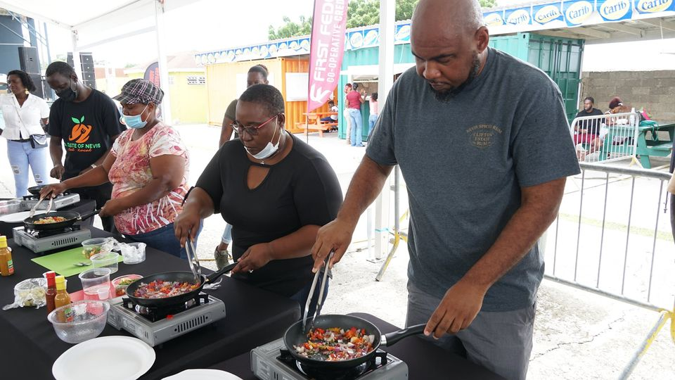 (far right) Mr. Huey Sargeant, Permanent Secretary in the Nevis Ministry of Agriculture participates in a Master Chef class during World Food activities at the Cultural Village in Charlestown on October 17, 2020