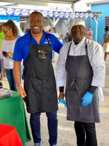 (l-r) Hon. Mark Brantley, Premier of Nevis and Minister of Tourism in the Nevis Island Administration congratulates Hon. Alexis Jeffers, Deputy Premier and Minister of Agriculture, winner of the Taste of Nevis Ministers' Cook-off at the Cultural Village in Charlestown on October 17, 2020