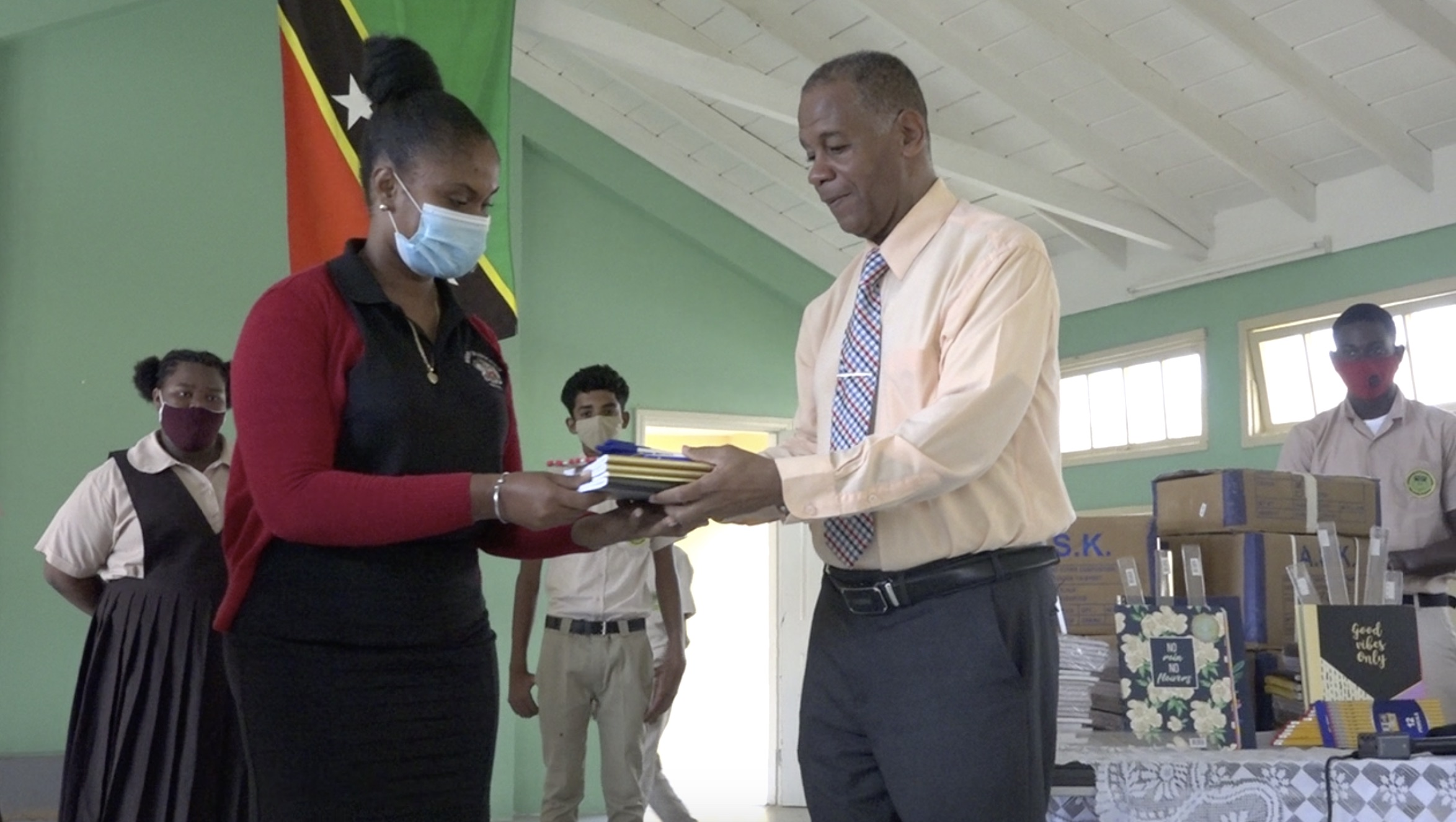 (l-r) Ms. Latoya Jeffers, Education Officer responsible for the Gingerland Secondary School accepts donation from Hon. Eric Evelyn, Minister of Youth and Community Development in the Nevis Island Administration, and area representative for St. George's, Gingerland on October 09, 2020