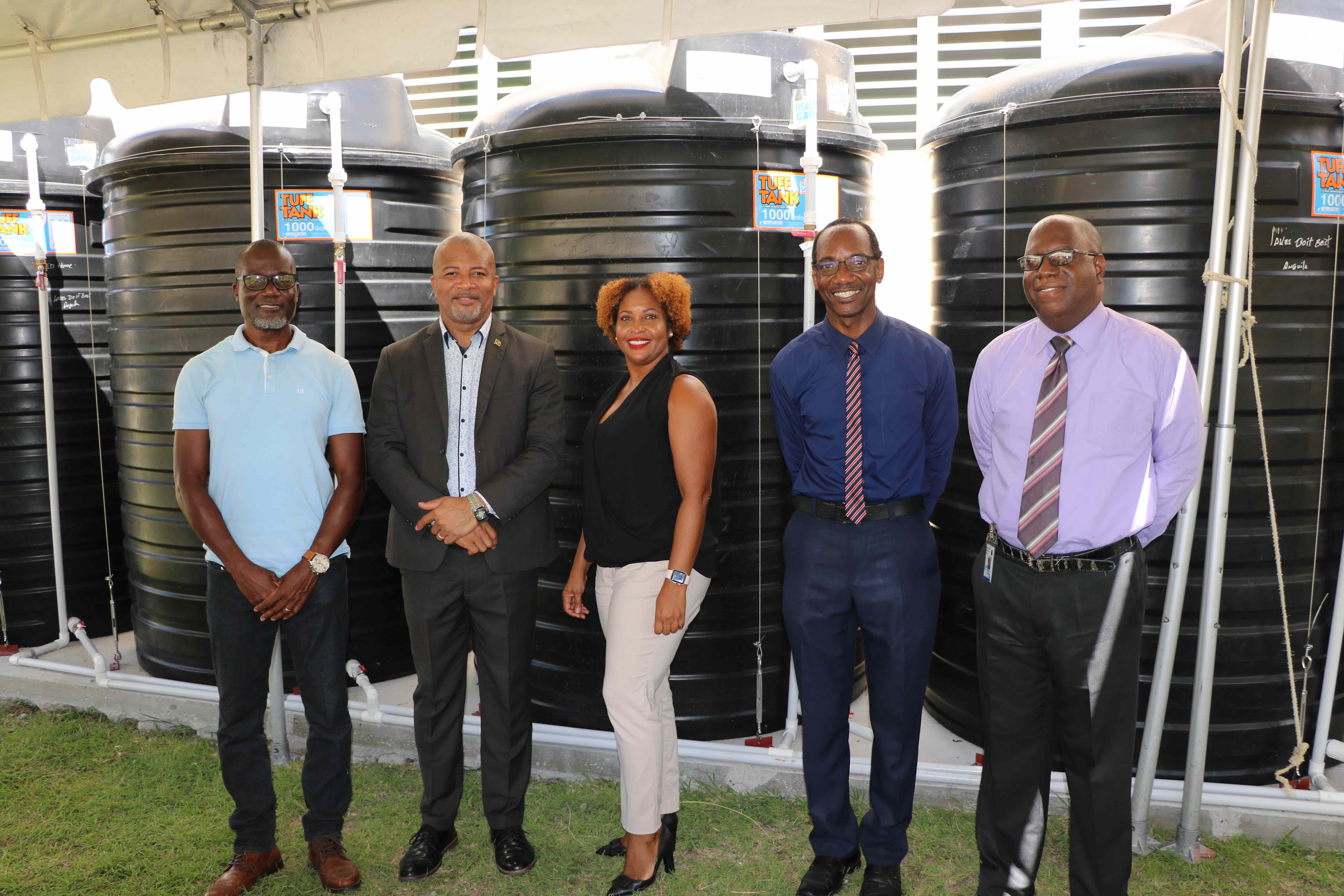 (l-r) Denison Paul of WaterWorks Solutions; Hon. Spencer Brand, Minister of Environment and Water Services in the Nevis Island Administration; Ms. Sharon Rattan, Permanent Secretary in the Ministry of Environment (St. Kitts); Kevin Barrett, Permanent Secretary in the Ministry of Education in the Nevis Island Administration; Juan Williams, Principal of Charlestown Secondary School at a ceremony to commission a water storage system at the Charlestown Secondary School on October 20, 2020