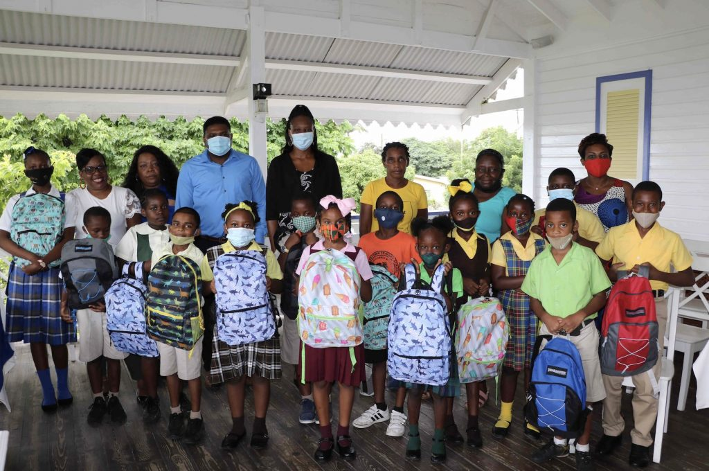 Members of the CCM Women's Arm with Hon. Troy Liburd, Junior Minister of Education in the Nevis Island Administration, with recipients of school supplies donated by the CCM Women's Arm on November 11, 2020