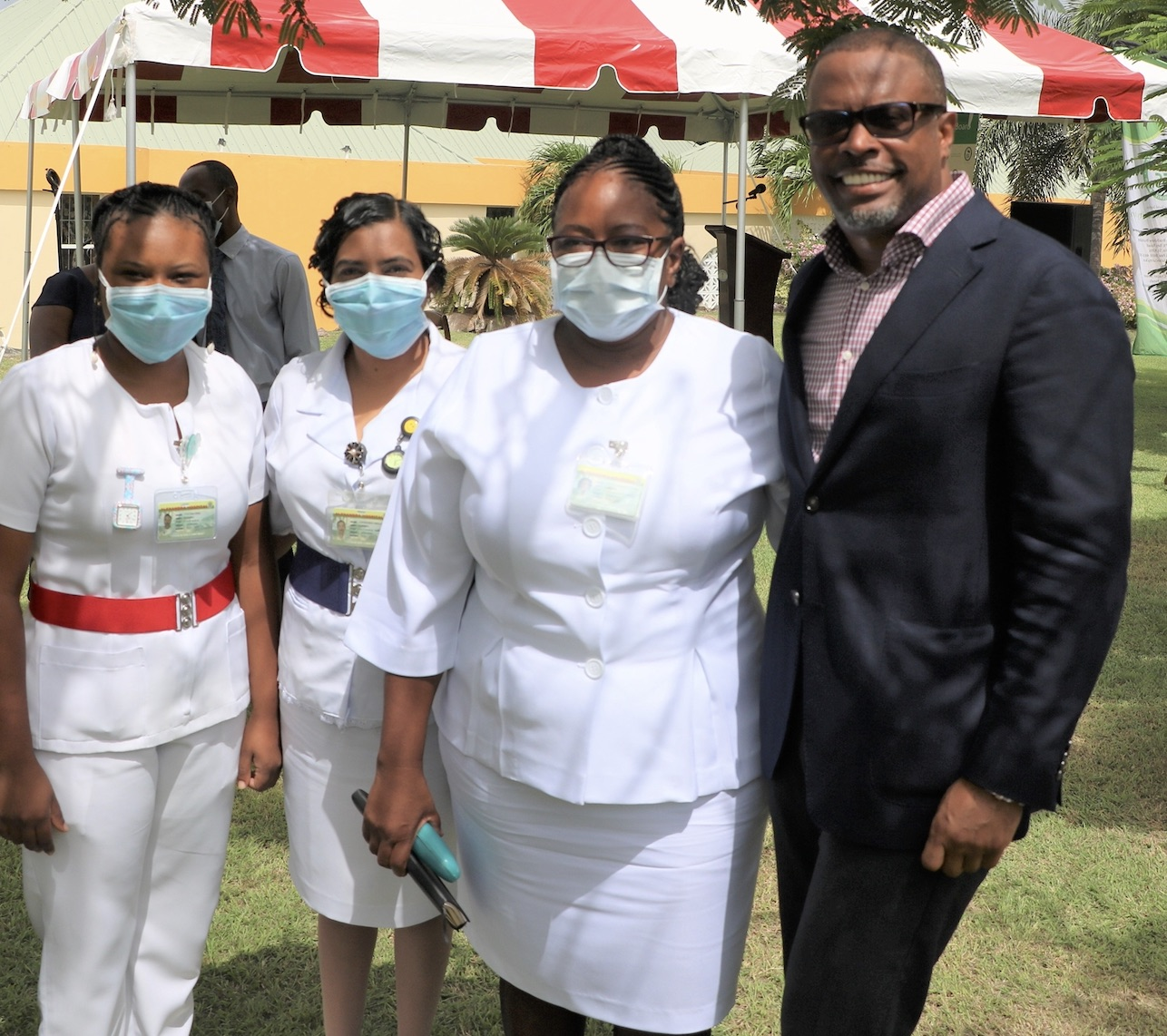 (far right) Premier of Nevis Hon. Mark Brantley, Minister of Finance and Senior Minister of Health in the Nevis Island Administration, with nurses at the Alexandra Hospital, Nevis (file photo)