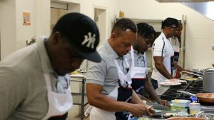 "Participants in the Department of Gender Affair's ""Men Can Cook"" programme during a session at the Charlestown Primary School's Cafeteria on November 23, 2020"