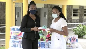 (l-r) Ms. Latoya Jones, President of the Concerned Citizens Movement Women's Arm presents a donation of essential personal care supplies on behalf of the group to Kella Didier, Registered Nurse for the residents of the Flamboyant Nursing Home on November 10, 2010
