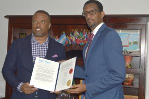 Dr. Yitades Gebre (right), representative of the Pan American Health Organization/World Health Organization to Barbados and Eastern Caribbean when he presented his credentials to the Hon. Mark Brantley, Premier of Nevis and Minister of Foreign Affairs (left) in Basseterre in February 2020 (file photo)