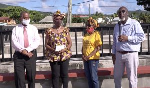 """(l-r) Hon. Eric Evelyn, Minister of Culture on Nevis with Mrs. Gloria Anslyn a member of the first Culturama Committee and Ms. Irma Johnson of the defunct Nevis Dramatic and Cultural Society and Mr. Antonio """"Abonaty"""" Liburd, Executive Director of Culturama at the Cultural Complex in Charlestown on December 02, 2020"""