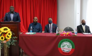 """Deputy Premier Hon. Alexis Jeffers, Minister of Agriculture, Cooperatives and Fisheries in the Nevis Island Administration at the podium, seating at the head table (l-r) Mr. Huey Sargeant, Permanent Secretary in the Ministry of Agriculture, Nevis; Hon. Mark Brantley, Premier of Nevis; and Mr. McLevon """"Mackie"""" Tross, Owner and Manager of A-1 Farms in Gingerland, featured speaker at the Ministry of Agriculture's Agenda forum 2021 on January 19, 2020 at the St. St. Paul's Anglican Church Hall, Charlestown"""