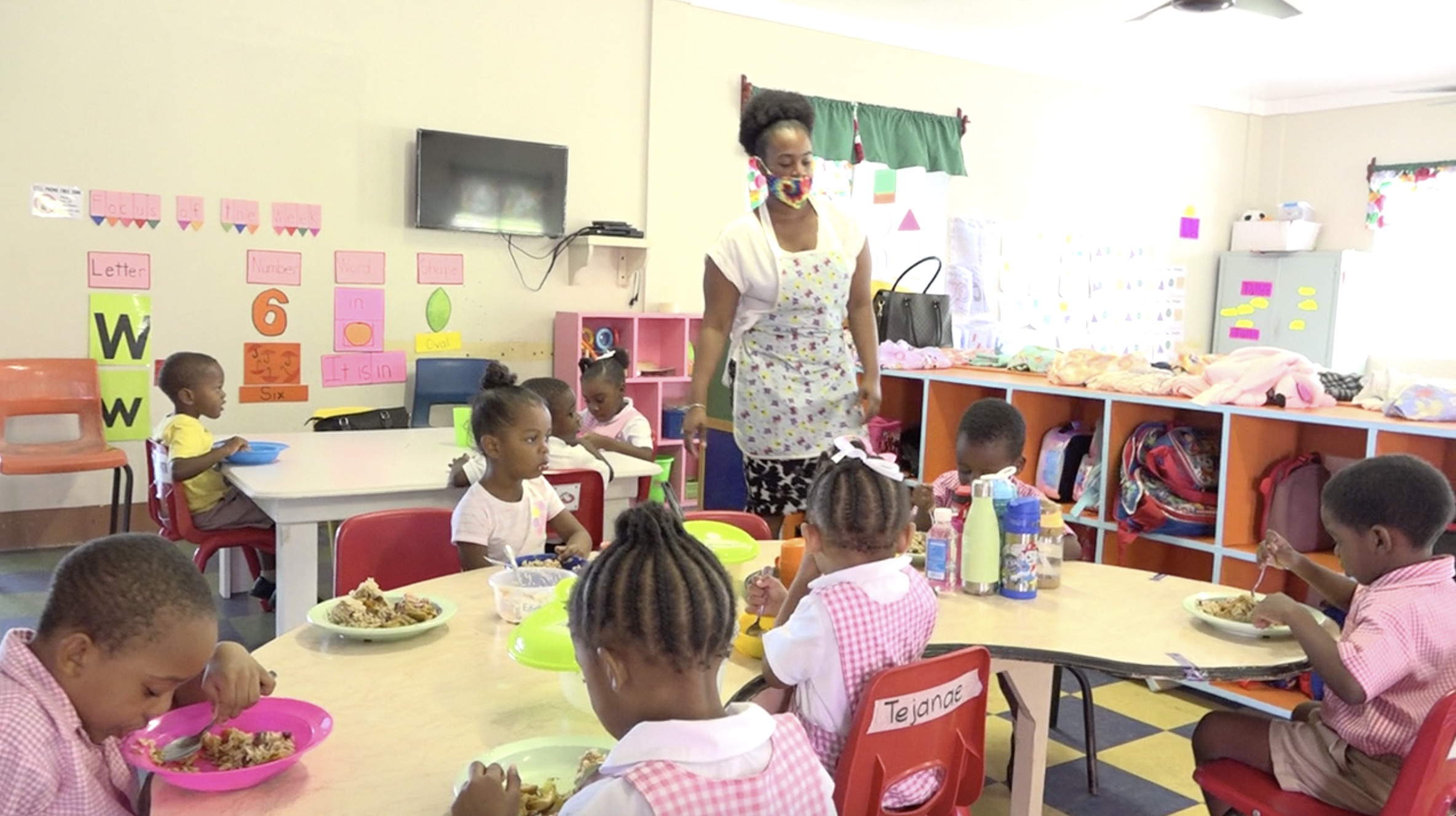"""Students from the Gingeland Preschool enjoying the national dish of Belize as part of the """"Tour around the Caribbean"""" initiative introduced in the Department of Education's School Meals Programme"""