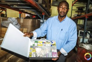 Mr. Brian Dyer, Director at the Nevis Disaster Management Department with some of the humanitarian supplies for the department from its long-standing partners the US Southern Command through the Minimal Cost Project at the US Embassy in Barbados