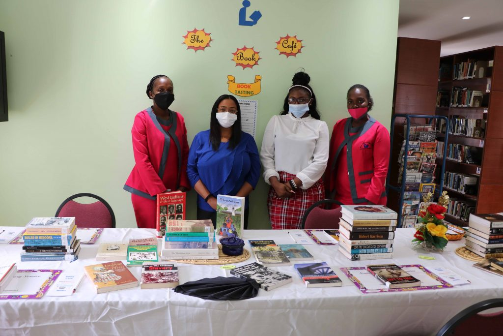 """Mrs. Anastasia Parris-Morton, Chief Librarian at the Nevis Public Library with staff members Ms. Tisha Brookes, Ms. Natalya Roberts and Ms. Janell Prentis with some of the books available for selection for a """"Book Tasting"""" from February 15 to 20, 2021 for Black History Month at the Nevis Public Library on Market Street in Charlestown"""