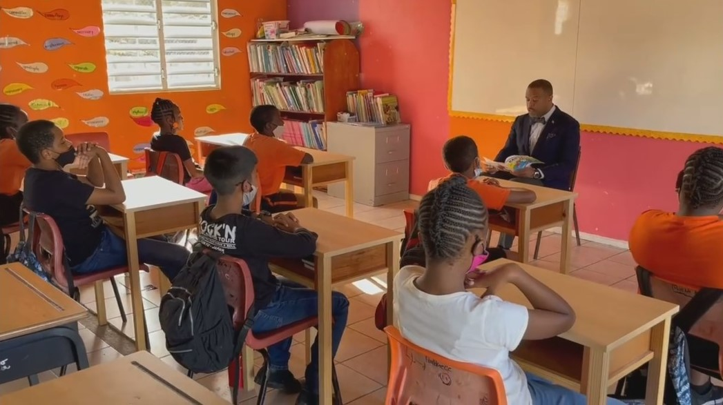 Hon. Mark Brantley, Premier of Nevis and Minister of Education in the Nevis Island Administration reading to Grade six students at the Charlestown Primary School on the occasion of World Read Aloud Day on February 03, 2021 at the Charlestown Primary School