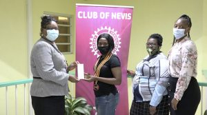 (l-r) Ms. Zahnela Claxton, Principal Education Officer in the Department of Education, Ms. Asieah Smithen, Acting President of the Rotaract Club of Nevis with members Ms. Tanisha Mills; and Ms. Latoya Jones at the handing over of a gift of thermometers from the Rotaract Club of Nevis