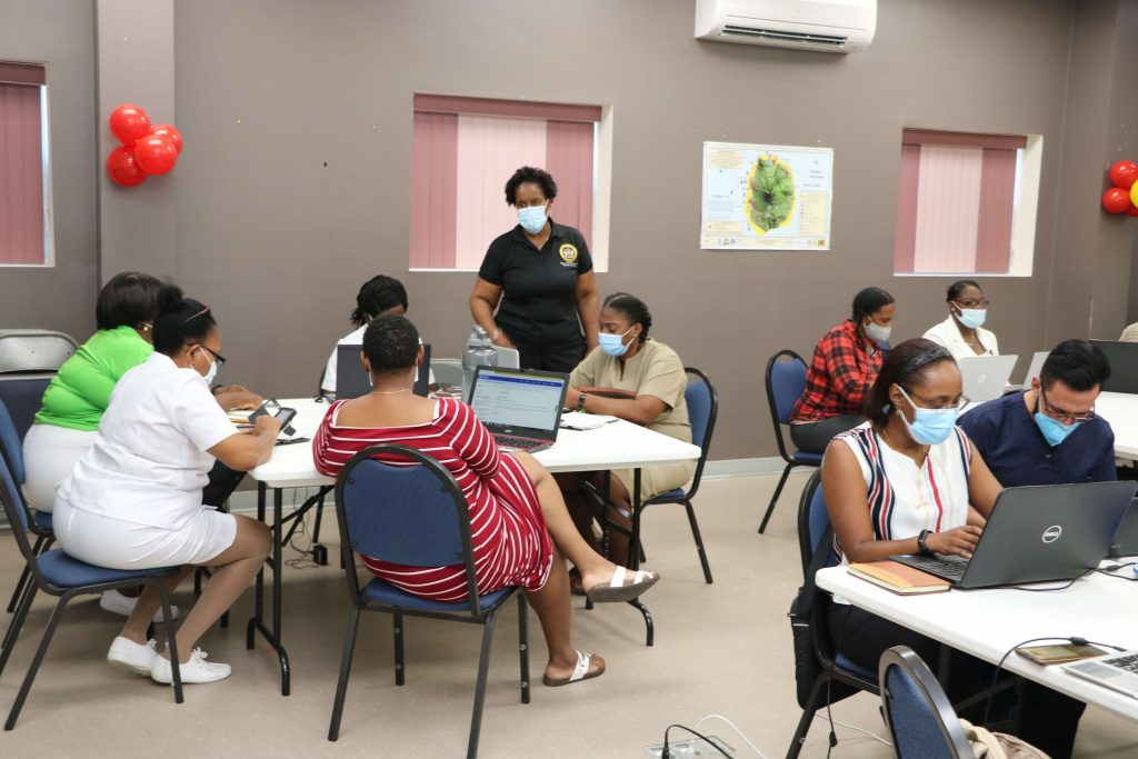 Dr. Judy Nisbett, Chair of the Nevis COVID-19 Task Force (standing) during the training session at the Disaster Management Department's conference room on February 19, 2021, with health professionals on Nevis in preparation for administering the AstraZeneca-Oxford vaccine in the fight against COVID-19