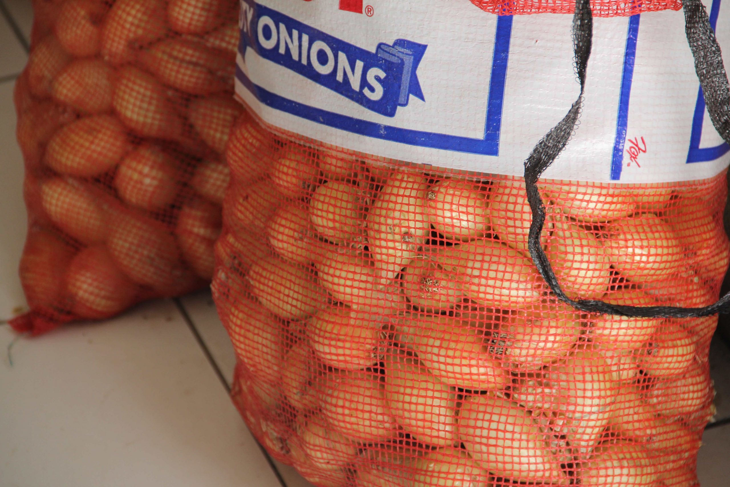 Locally grown onions in storage at the Department of Agriculture Marketing Unit will be among other local produce on sale at Agrofest at the Villa Grounds in Charlestown on March 26, 2021 (file photo)