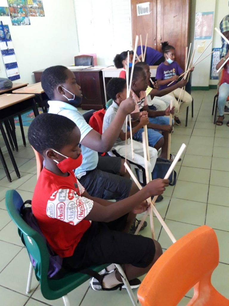 A section of the public primary school students from across Nevis learning the art of kite making on March 29, 2021, the first of a three-day Ministry of Education Kite Making Workshop at the Elizabeth Pemberton Primary School with sponsorship from the Hamilton Reserve Bank