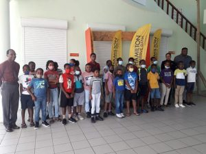 Participants at the Ministry of Education's three-day Kite Making Workshop for public primary schools with officials and sponsor representative at the opening ceremony at the Elizabeth Pemberton Primary School on March 29, 2021