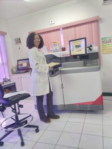 Ms. Julene Grant, Lab Technician at the Alexandra Hospital's Lab on March 25, 2021, with the newly installed and commissioned VITROS XT 3400 chemistry analyzer