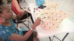 A participant at the at the Department of Gender Affairs' three-week Basket Weaving Workshop for women weaving a basket at the Pond Hill Community Centre on April 22, 2021