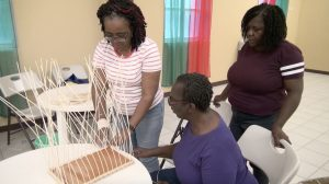 Ms. Marilyn Pemberton local Basketmaker for more than 26 years and facilitator at the Department of Gender Affairs' three-week Basket Weaving Workshop at the Pond Hill Community Centre instructing participants at a session on April 22, 2021,