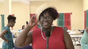 Hon. Hazel Brandy-Williams, Junior Minister of Health and Gender Affairs showing off a multi-use basket she wears as a hat on April 22, 2021, the work of a participant at the Department of Gender Affairs' three-week Basket Weaving Workshop for women at the Pond Hill Community Centre