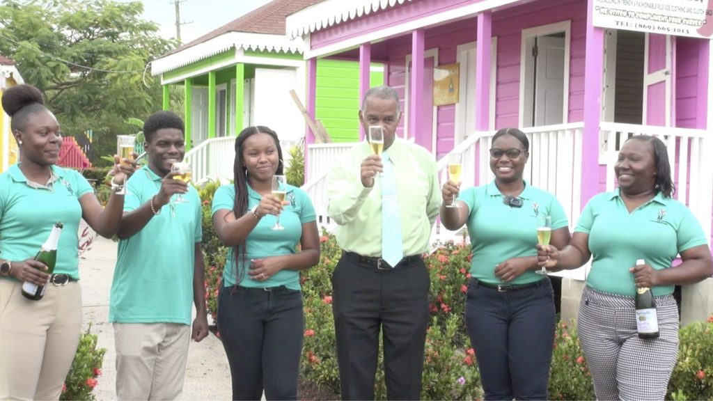 Hon. Eric Evelyn, Minister of Youth in the Nevis Island Administration raises a toast in honour of Mother Earth on Earth Day at the Artisan Village on Thursday, April 22, 2021, with members of staff at the Department of Youth including Ms. Kerdis Clarke, Director of Youth (standing on his immediate right)