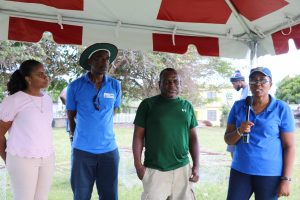"""(L-r) Ms. Latoya Jeffers, Assistant Secretary in the Ministry of Health and Gender Affairs; Mr. Lemuel Pemberton, Deputy Director of Marine Resources at the Department of Marine Resources in St. Kitts and Nevis; Mr. Robert """"Bit"""" Clarke, President of the Jessups Cotton Ground Barns Ghaut Fisherfolk Association; and Ms. Catherine Forbes Training Officer at the Department of Gender Affairs at the department's Fish Trap Making Workshop for boys and young men at the Jessups Playing Field on May 08, 2021"""