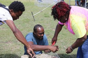 Hon. Hazel Brandy-Williams, Junior Minister of Health and Gender Affairs in the Nevis Island Administration interacting with participants at the Department of Gender Affairs' Fish Trap Making Workshop for boys and young men at the Jessups Playing Field on May 08, 2021