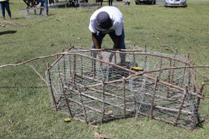 One of 20 participants bracing a fish trap at the Department of Gender Affairs' Fish Trap Making Workshop for boys and young men at the Jessups Playing Field on May 08, 2021