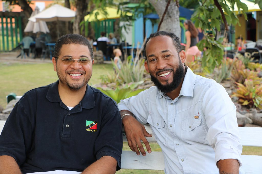 (L-r) Mr. Michael Henville, President of the Caribbean Foundation for Children Inc; and Mr. Jahreem Encarnacion, the foundation's Vice President speaking with the Department of Information on May 14, 2021 in Charlestown