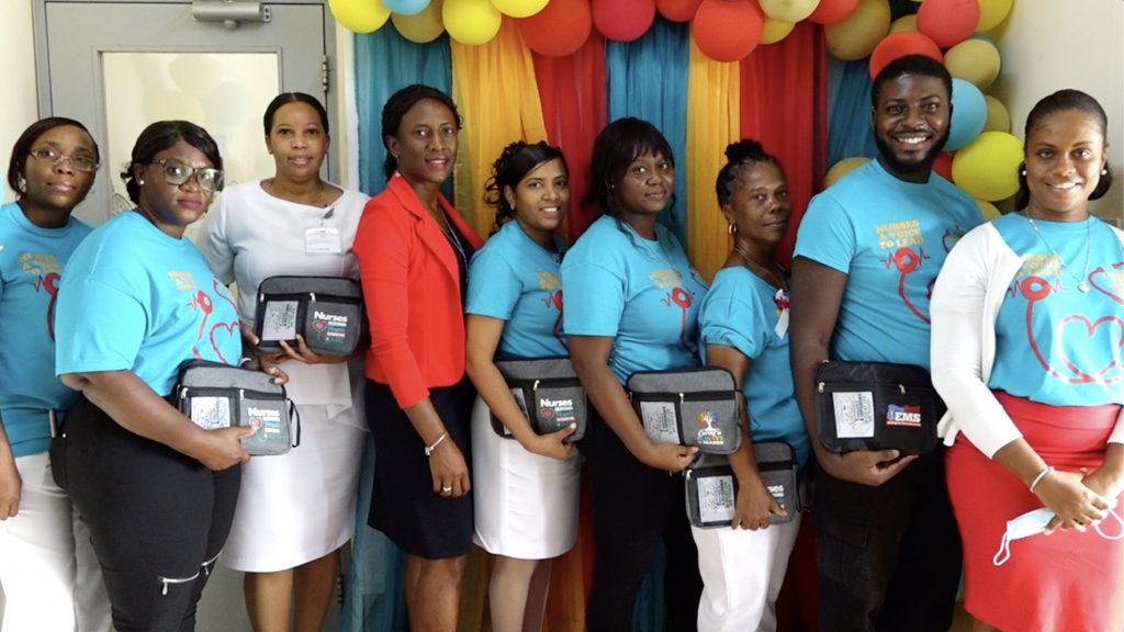 (L-r) Assistant Matron Gracelyn Hanley; Mrs. Simone Harris, President of the Nevis Nurses Association; Assistant Matron Dhaima Golding; Ms. Shelisa Martin-Clarke, Permanent Secretary in the Ministry of Health; Matron Chandreka Persaud-Wallace; Ms. Colleen Hanley, nursing attendant; Ms. Donna Hanley, Nurse Manager at the Flamboyant Nursing Home; Mr. Roan Bramwell, emergency medical technician; and Ms. Latoya Jeffers, Assistant Secretary in the Ministry of Health share a light moment at the Alexandra Hospital on International Nurses Day, May 12, 2021