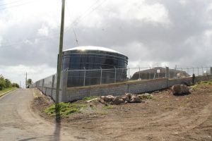 A section of the new perimeter fencing at the Nevis Water Department's Hamilton Reservoir  Site Fencing Project  near the Aquastore glass fused  400,000 imperial gallons storage tank (left) and  the 100 year-old stone reservoir (right) on July 22, 2021