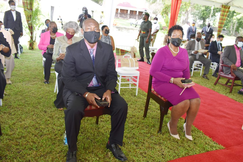 (l-r) Awardees from Nevis Mr. Brian Dyer and Dr. Judy Nisbett, Co-Chair and Chair respectively of the Nevis COVID-19 Task Force at the Investiture Ceremony at Government House in St. Kitts on August 17, 2021