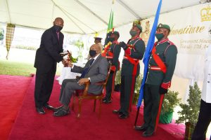 Mr. Brian Dyer receiving a 2020 Medal of Honour from Sir Tapley Seaton, Governor General of St. Kitts and Nevis on August 17, 2021, at an Investiture Ceremony at Government House in St. Kitts for his outstanding contribution to National Service in Crisis