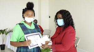Nathalia Nanton of the Joycelyn Liburd Primary School receives Naomi Daniel-Browne Scholarship Award from Mrs. Adina Taylor, sister of the late Naomi Daniel-Browne