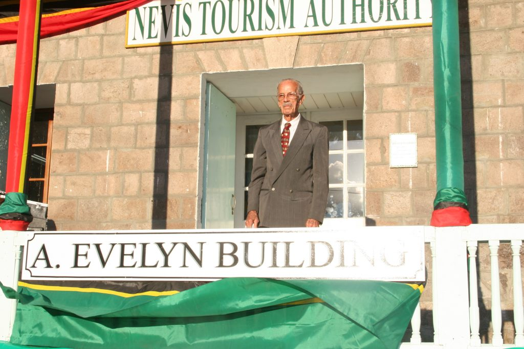 The late Mr. Arthur Evelyn, the First Minister of Tourism on Nevis, moments after unveiling the new name of the Old Treasury Building in Charlestown in 2010 renamed in his honour by the Nevis Island Administration