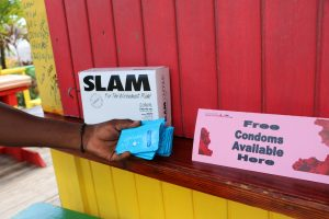 A sign indicating the availibity of free condoms along with condoms and packets of lubricant delivered to Sunshine's Beach Bar and Grill on August 04, 2021, by the Nevis Health Promotion Unit as part of its initiative to promote condom use to fight against HIV and other sexually transmitted infections