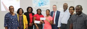 Ms.Dhakiya Liburd and Ms. Asher Walters-Hanley, recipients of the Medical University of the Americas and the Nevis Island Administration (NIA) Scholarships for 2021/2022 with MUA and NIA officials and their parents at the award ceremony held at the Ministry of Gender Affairs conference room on July 30, 2021